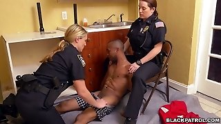 Caucasian police officers screw black scofflaw in threesome