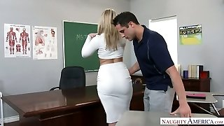 Immensely sexy giant racked blond professor was fucked right on the table
