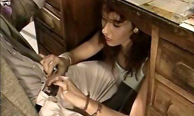 Slutty secretary gives her boss a fellatio under the table