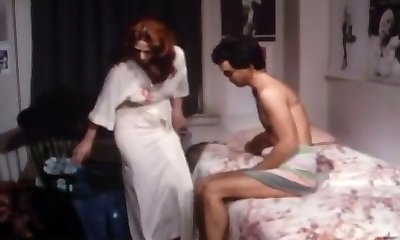 Redhead mother seduces a young man