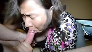 Asian wife swallows load and cute peeks down half-top