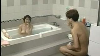 Busty Japanese Girl In The Bathroom