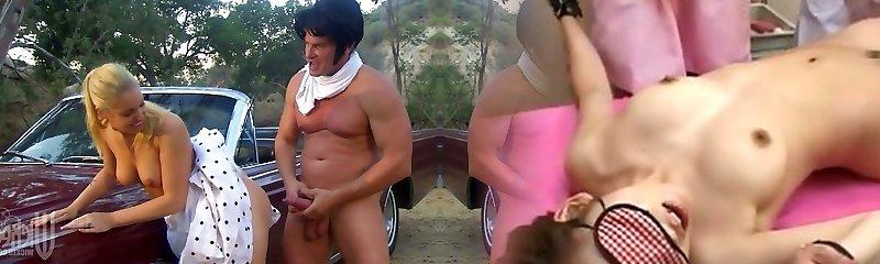 Hollie Stevens in polka-dot dress gets fucked on the retro car fetish mask