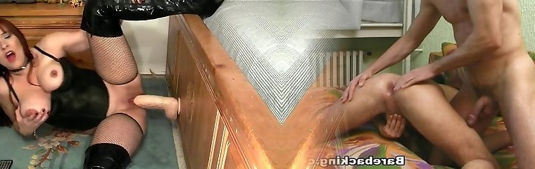 Horny chick plays with a big white fake penis.