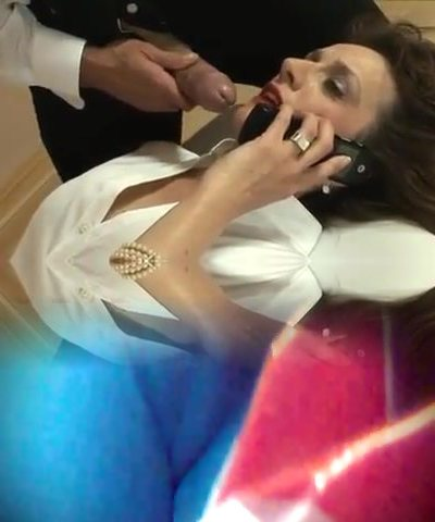 Brit Milf Plays With A Salami While On The Phone