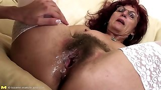 Deep fisting for sexy mature mom's hairy muff