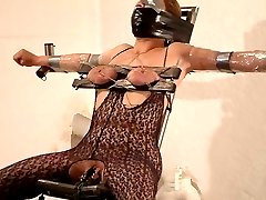 Placing saran wrap over my slaves face during her breast bondage session really turns me on.