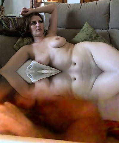 Busty mature brunette with huge boobs and wooly pussy strips