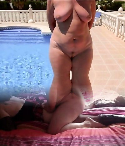 A mature girl with a naked obese butt walks by the pool