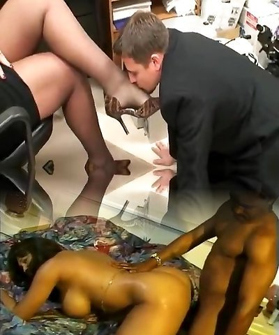 tall mature lady in office with  her foot gimp