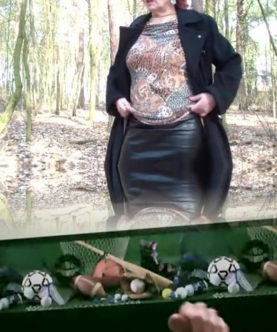 Mature lifts micro-skirt in the forest