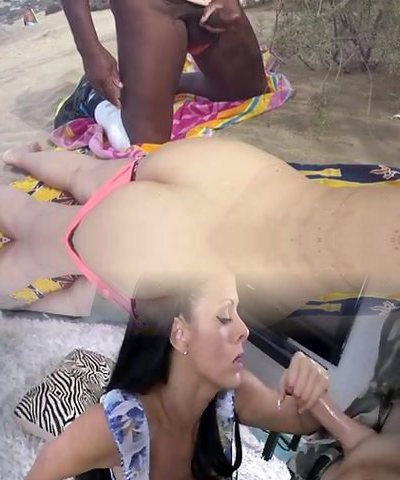 Mummy sharing with huge black cock on the beach