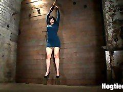 Welcome Annika to Hogtied, it is not often that we get Members of the site on the site, so when we do it's pretty freaking awesome. There is no attitude in life that a brutal crotch rope won't fix.  If you're in a good mood, it can quickly put you in a bad mood.  If you're in a nasty mood, it can be used as a tool to put you in a better mood, or else..     Annika suffers on the wall as we strip, molest, abuse and adore her hot body. Her nipples are worked over and we rip orgasm after orgasm out of her helpless body.  The crotch rope serves, and it serves us well..