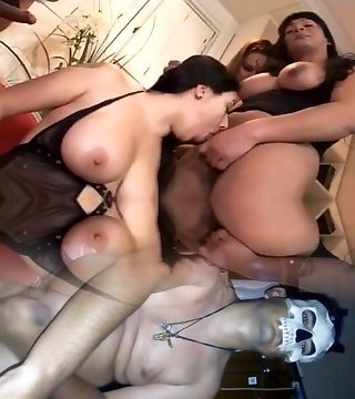 Four shemales with gang-fuck a girl