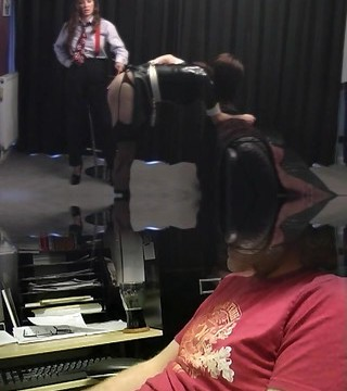 Mistress gives marvelous latex shemale maid a good ass spanking and breast sucking
