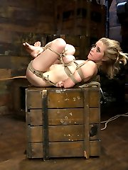 Beautiful, Blonde, blue-eyed Penny Pax is dragged in by her hair by professional sadist Mark Davis. Then strung up by one ankle with her massive tits tied to rocks the floor. Mark slaps her around and puts his cock down her little throat. He tickle tortures her and spits in her face. The little slut loves the extreme bondage and humiliation so much that Mark has to punish her for her insubordination. Then Penny gets tied to a post with her legs tied to a spreader bar, her breasts smashed between two tied bars and a crotch rope tied to the ceiling. First thing Mark does is pull down on the crotch rope to put her on her tippy toes. She gets her tongue confined by sticks and her nipples tortured with clamps ties to the spider gag in her mouth. With the crotch rope tight she is made to orgasm as Mark finger bangs her and presses a vibrator into her clit. Then she gets hogtied with an anal hook. Mark pulls into the air then crams his big dick down her throat. She has her fingers tied to nipple clamps and her hair in bondage. Mark has fun choking her with his cock then puts a gag on her and puts a huge dildo up her as and a vibrator on her pussy. Lastly Penny is suspended in the fetal position and Mark canes her feet and flogs her ass. He then crams his cock down her throat some more and pushes her to cum.