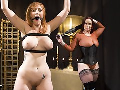 Mistress Bella Rossi has redhead bombshell Lauren Phillips bound and at her mercy. Lauren begs for orgasm while submitting to flogging, spanking, and finger banging. Next, Lauren is bound with all her holes exposed for her Mistress's pleasure. Lauren worships Bella's stocking-clad and naked feet before servicing her Mistress with enthusiastic pussy licking and ass licking. As a reward for bringing her Mistress to orgasm, Lauren gets a vigorous dick-on-a-stick fucking and tons of orgasms. Finally, Lauren is strap-on fucked in her pussy and ass while she continues to come over and over.