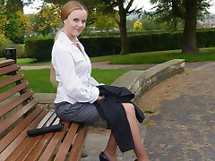 Cute blonde Claire shows her great legs and high heel shoes out in the park