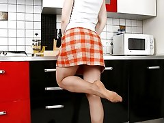Freaky chick knows the best way to show off her nyloned feet in the kitchen