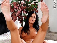 There's something about India that drives everyone crazy. It could be her beautiful body or her tiny soft nipples, but we at Foot Fetish Daily think it's her scrumptious soles and toes. Since this is a footjob scene, you're going to see this horny MILF stroke her partner's dick - noticeably getting off. It's so hot to see a pair of feet this sexy getting creamed. What do you think?