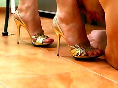 Perfect mistress with ideal feet forcing the slave to kiss this treasure