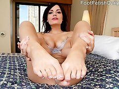Alexis caught her boyfriend Kurt looking at other girls' feet, and she is upset. She never lets Kurt suck or touch them because she is so ticklish. If she wants to keep her man's eyes on her feet, she is going to have to give in a little. She lets him explore them with her mouth and finally starts to enjoy the foot worshipping. She wraps her little toes around his cock before she gets so turned on from the footjob that she has to suck and fuck his huge cock.