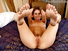 Natasha and Mickey can't keep their hands to themselves. Natasha can't keep her feet off Mickey's cock or out of his mouth. She gives an amazing footjob before he fucks her hard while sucking her toes. He blasts his load all over the soles of her feet, and she loves every minute of it.