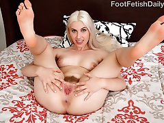 Niki can't wait for her boyfriend to get home. She is playing with her perfect pussy with her feet in the air, just the way he likes it. She gives him her feet to worship and strokes his cock with her toes. He fills her perfect pussy with his cock then blasts his load all over her feet.