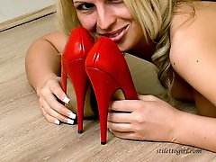 Gorgeous Rachel is working her red high heels and lingerie