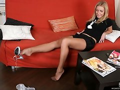 Smoking hot platinum blonde eating each toe of her tastey nylon dressed feet