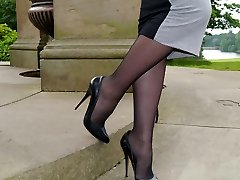 Mind-blowing dark haired Sophia gets out the office to walk and tease outdoors in nylon tights and high stiletto heels