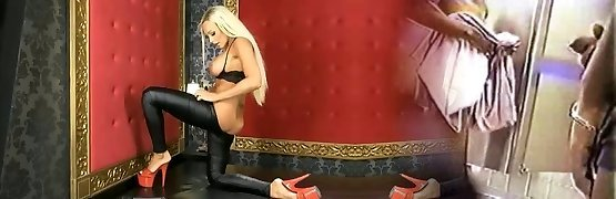 Lucy Summers in glossy spandex and red heels on BS