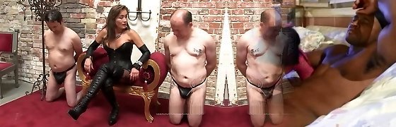 Leather mistress whips her sub before he gets sold