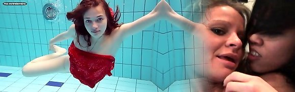 Red haired girl Libuse swimming in a pool in fire crimson dress